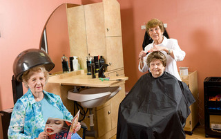 Residents getting hair done at the senior living in Palmyra