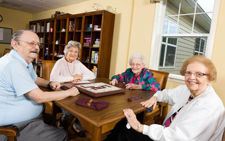 Residents playing board games at the senior living in Palmyra