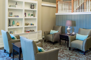 Relax in the library in Hopkins senior living