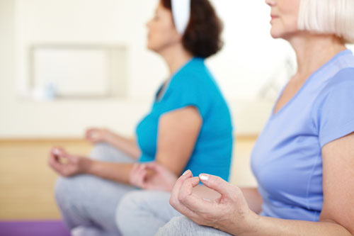 Yoga is one of many active recreation programs available at The Birches at Arbour Square