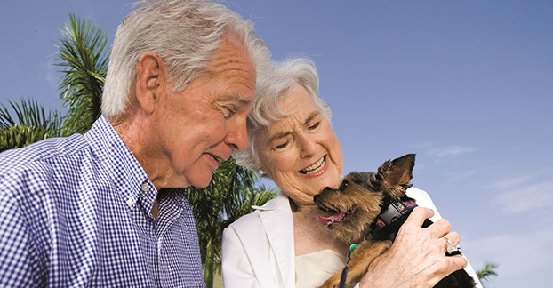 Couple and puppy naples senior living