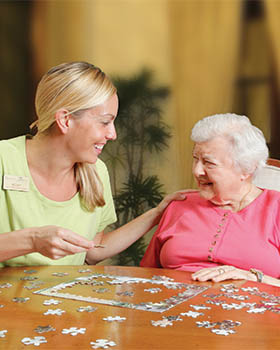 Windham Terrace senior living resident working on a puzzle.