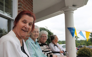 Residents on porch at harleysville senior living