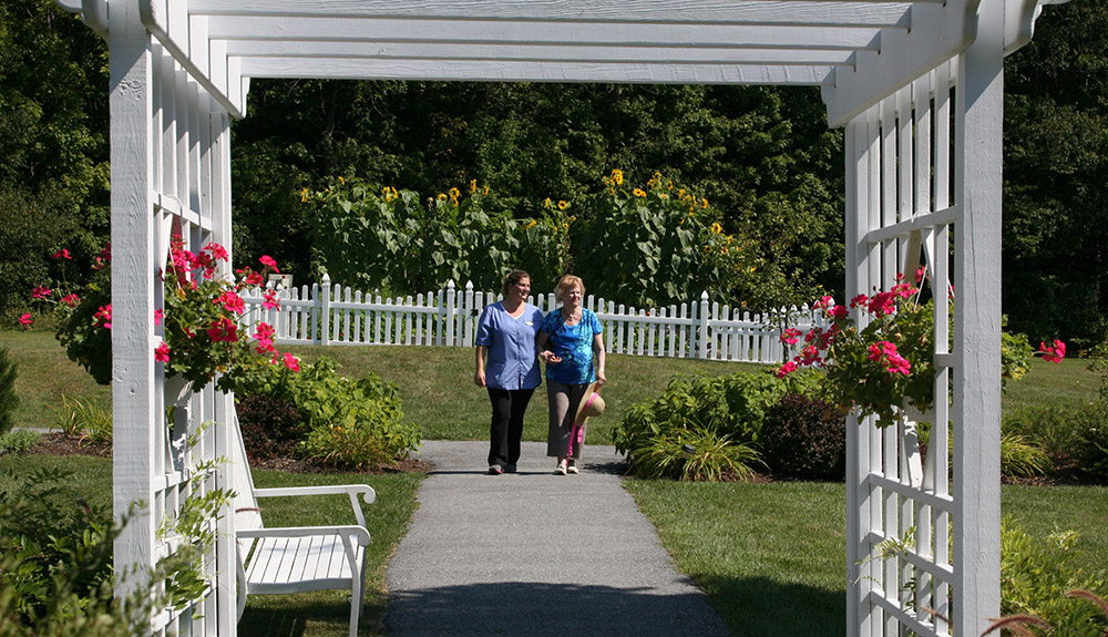 Seniors walking in the garden at Manchester Center, VT senior living.