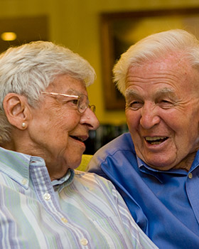 Seniors at Manchester Center, VT share a joke at Equinox Terrace.