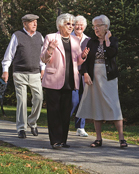 Woodstock VT seniors out on a walk enjoying the day in.