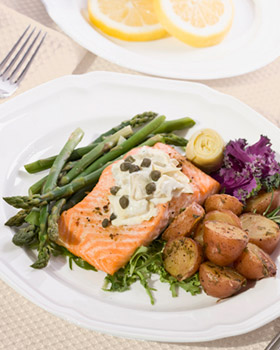 Woodstock VT salmon dinner presented at assisted living at Woodstock Terrace.