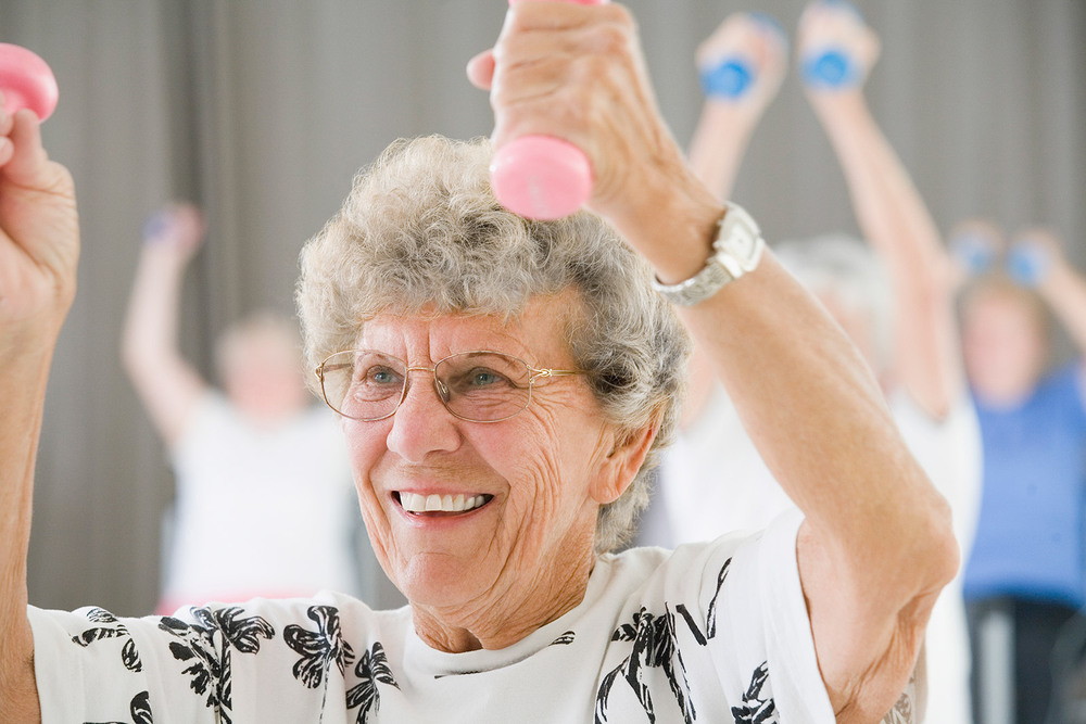 Senior living manchester center excercising woman