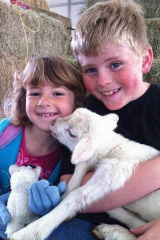 Happy kids with goat at murrieta veterinary hospital