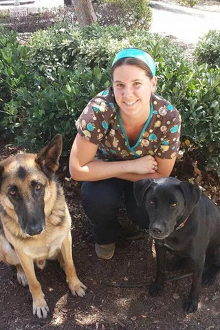 Murrieta veterinary hospital staff with dogs