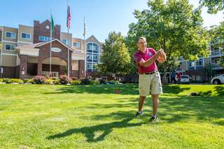 Residents enjoying wiffle golf on campus