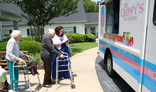 Residents getting ice cream at the ice cream truck in Greenville senior living