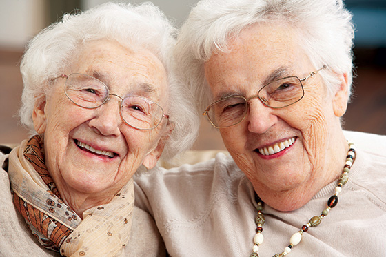 Friends share joy at our assisted living facility in Scarborough, ME.