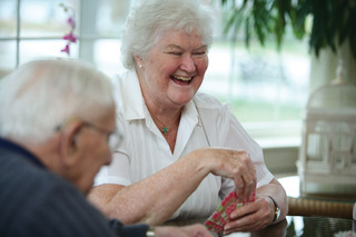 Laughing during the card game assisted living at tequesta