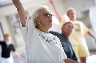 Woman lifting weight tequesta senior living