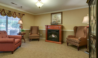 Fireplace at farmington assisted living building