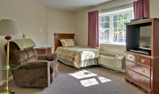 Assisted living community model bedroom in ashland