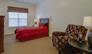Memory care senior living bedroom model