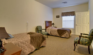 Twin bedroom at fairview heights memory care