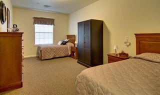 Twin bedroom at olive branch memory care