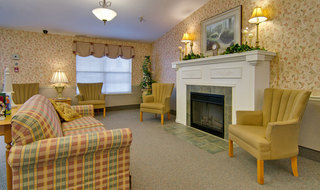 Skilled nursing lounge in dexter with fireplace