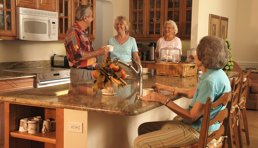 Friends enjoy each others company at senior living in Tequesta, {[store.state}}