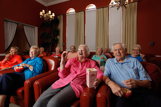 Seniors laughing and enjoying a movie