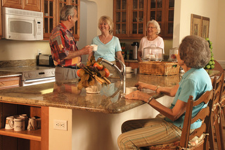 Friends gather to relax at tequesta senior living bright