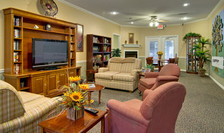 Tv lounge at olive branch assisted living