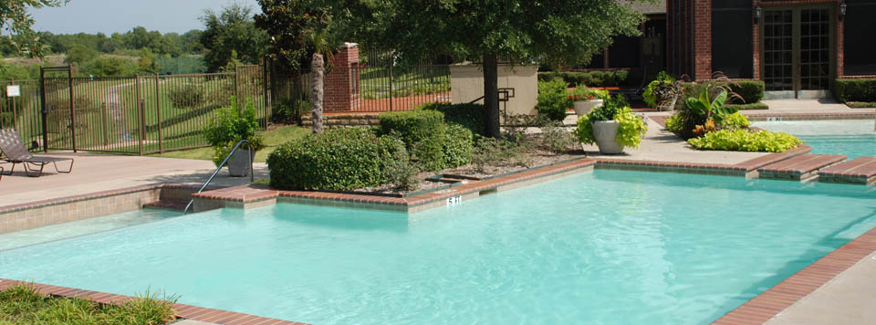 Apartment rentals pool area in Grand Prairie