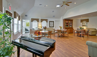 Union assisted living dining area with piano
