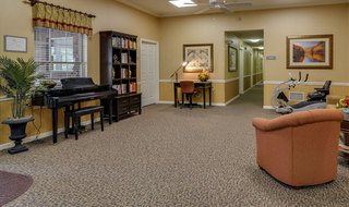 Community area with piano in jefferson city assisted living