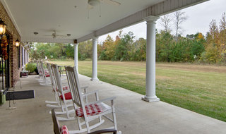 Porch seating at starkville assisted living community