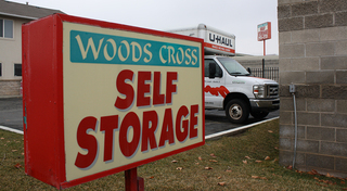 Very large storage unit in woods cross
