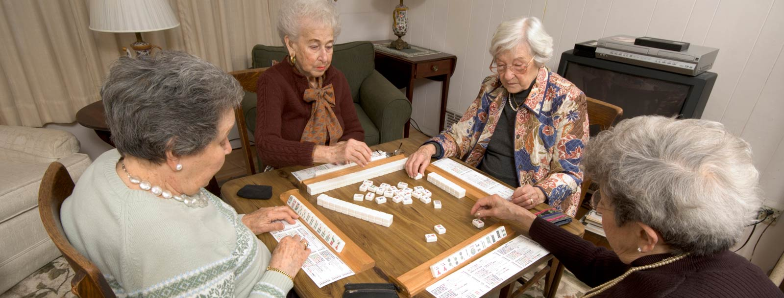 Residents playing dominoes at the senior living facility in Didge City