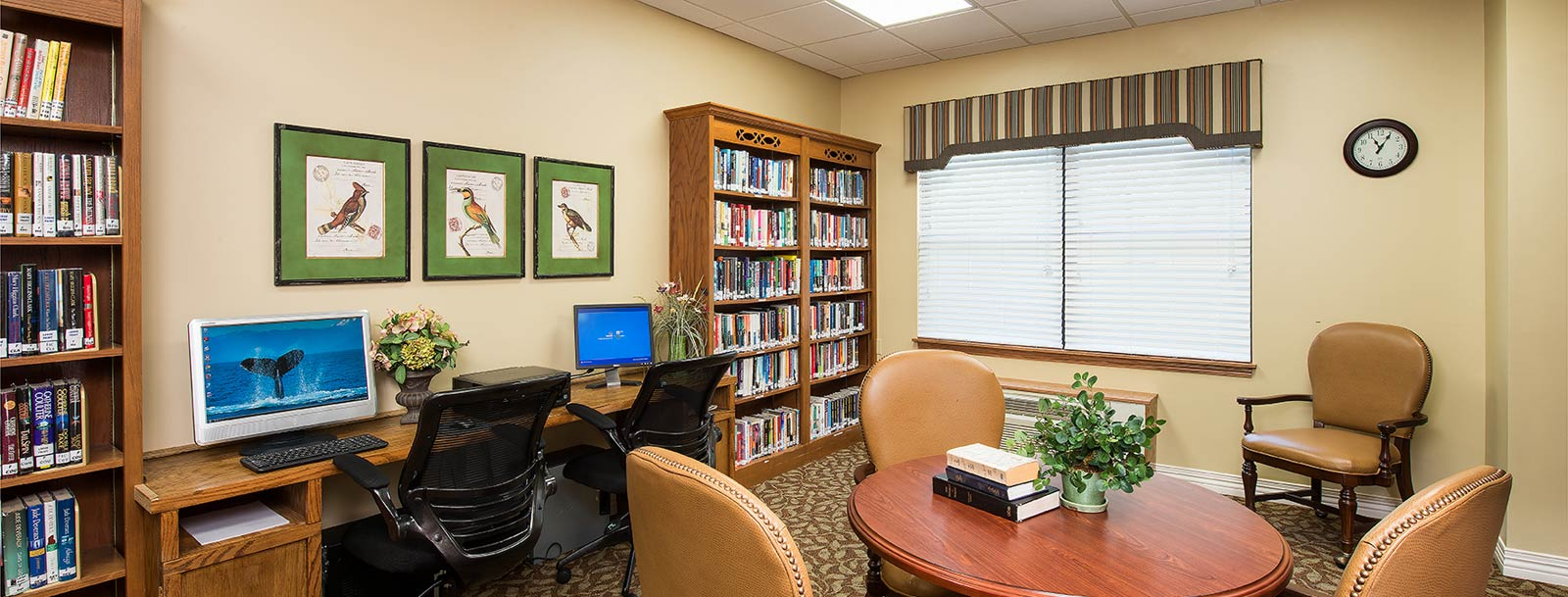 Residents enjoying the library at the senior living in Arkansas City