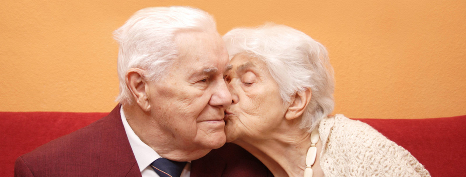 Happy couple kissing at the senior living in Topeka