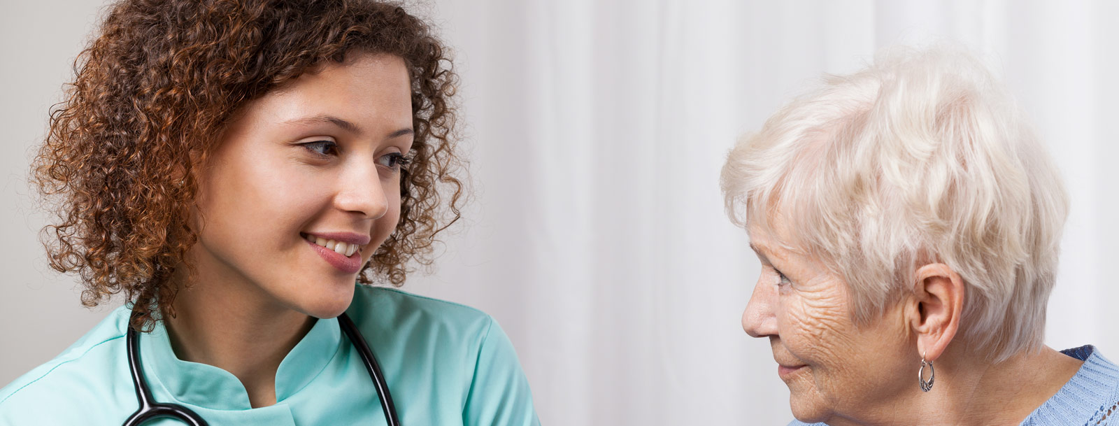 Resident getting help from a friendly doctor in Rolla senior living