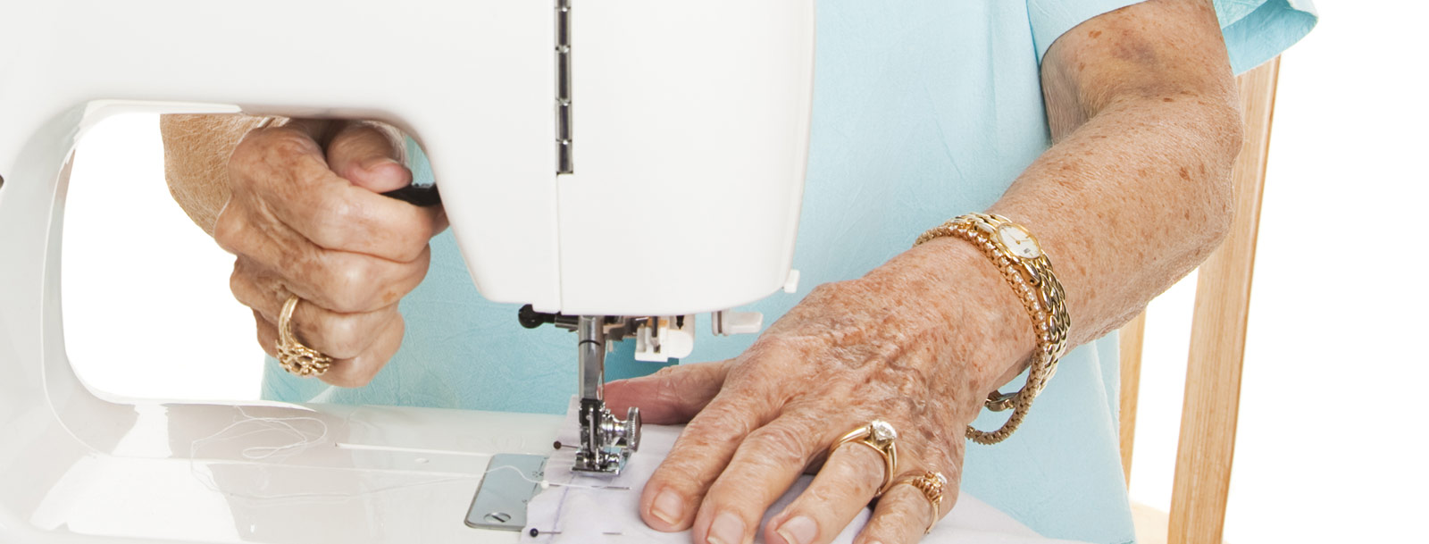 Resident sewing at the senior living community in Farmington