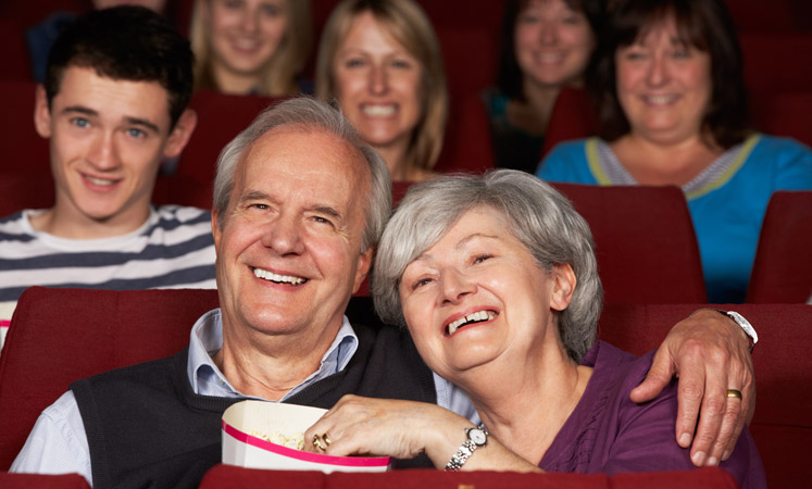 Couple enjoying a movie at the senior living in Wichita