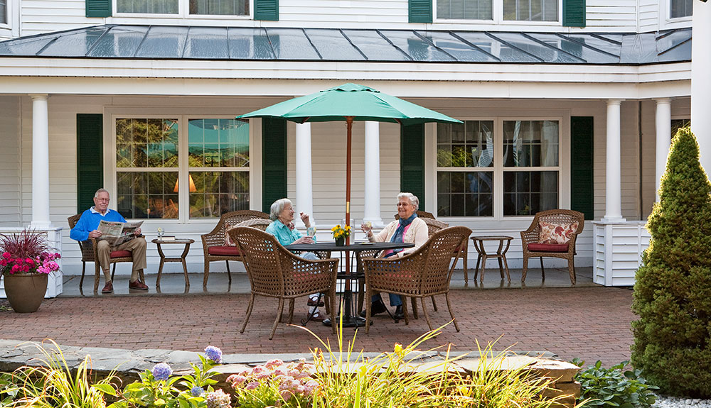 Assisted living friends share a moment at a senior living facility in Scarborough, ME.