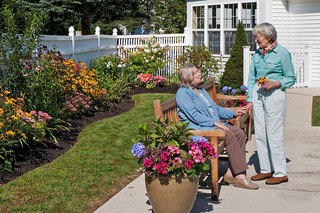 Friends chat at senior living in maine
