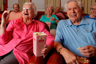 Seniors enjoying a movie best assisted living in maine