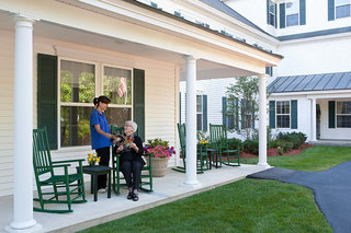 Seniors on a porch assisted living bliss