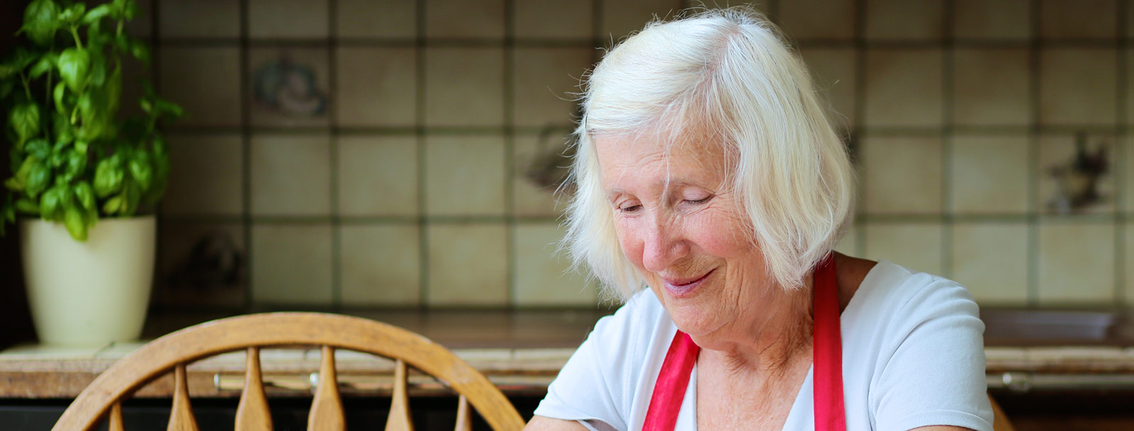 Happy resident baking at the senior living community in Sterling