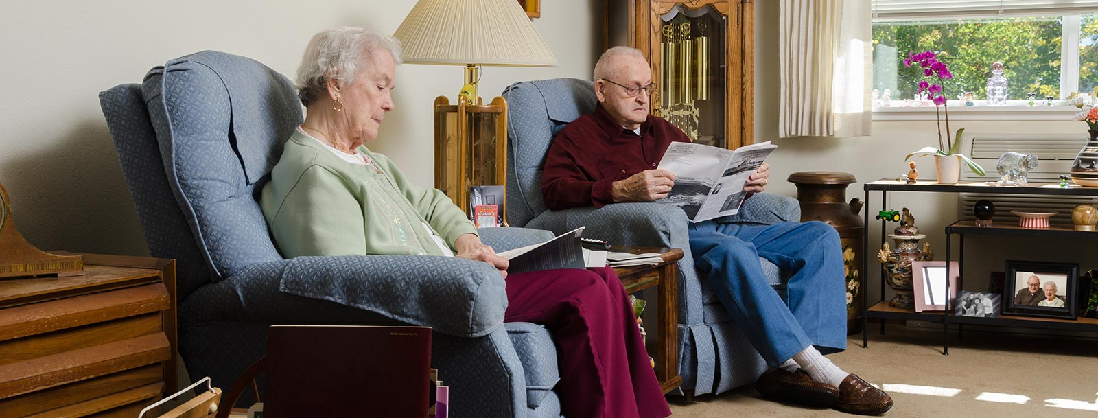 Happy couple reading at the senior living facility in Fulton