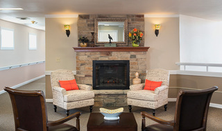 Fort Scott senior living has a cozy fireplace