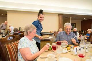 Residents enjoying restaurant style dining dhb 6801