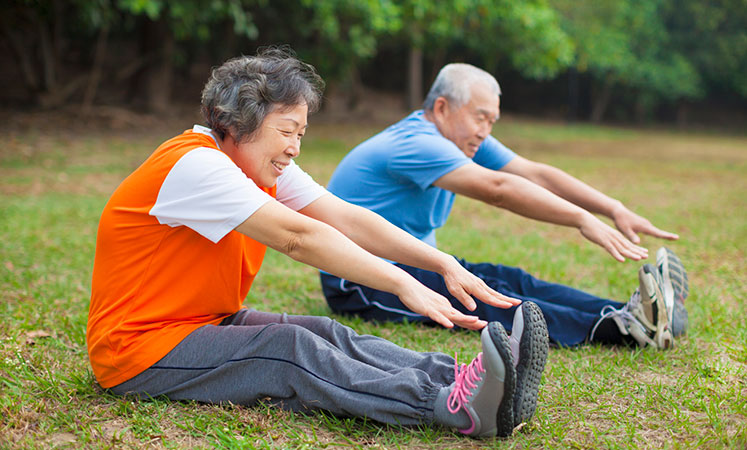 Residents stretching in Salina senior living facility