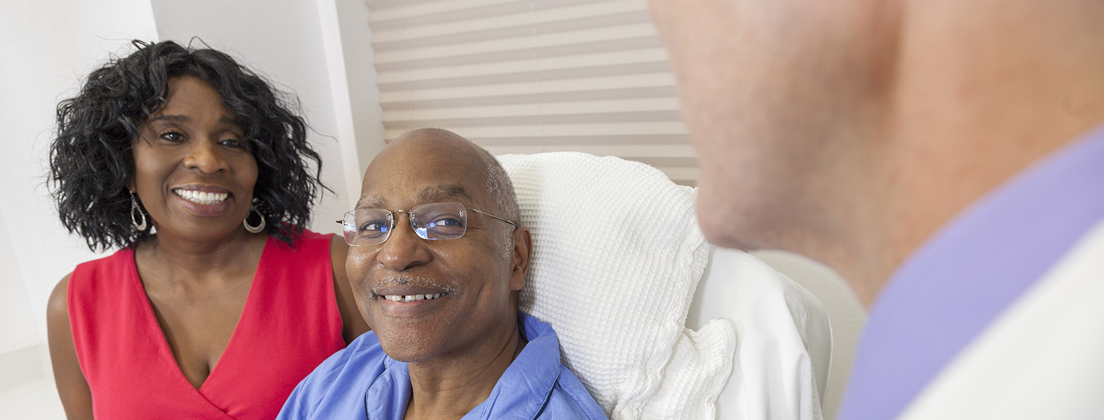 Resident getting help from a friendly doctor in Olathe senior living